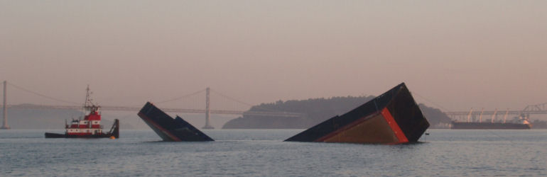 Hopper barge salvage - buckled barge grounded