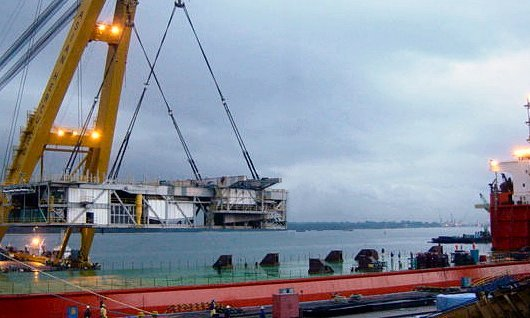 Mad Dog DSM lifted on by floating crane