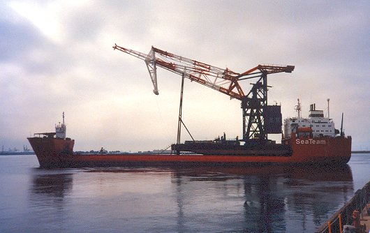 Sea Swan departing with Titan crane on deck